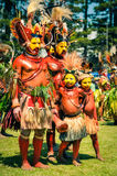 Men and boys in Papua New Guinea. Hagen show, Papua New Guinea - circa August 2015: Half-naked men during Hagen show, Papua New Guinea. Documentary editorial Royalty Free Stock Image