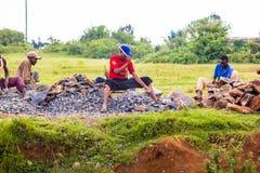 Men breaking rocks Royalty Free Stock Photos