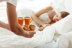 Men brings breakfast to bed Royalty Free Stock Photography