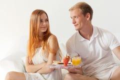 Men brings breakfast Stock Photography