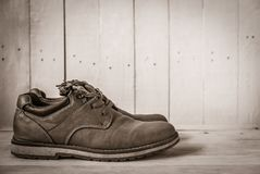 Men brown shoes on white wooden table. With vintage style Royalty Free Stock Photos