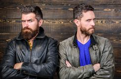 Men brutal bearded hipster. Confident competitors strict glance. Masculinity concept. Masculinity attributes. True man. Men brutal bearded hipster. Confident stock image
