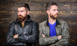 Men brutal bearded hipster. Exude masculinity. Confident competitors strict glance. Masculinity concept. Masculinity. Attributes. True men temper. Brutality royalty free stock images