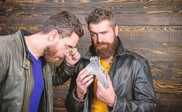 Men brutal bearded hipster wear leather jacket and hold cash money. Illegal profit and black cash. Guy mafia dealer with stock photos