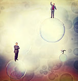 Men on bubbles Stock Images