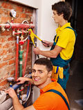 Men builder fixing heating system . Stock Images
