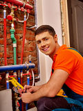 Men builder fixing heating system Royalty Free Stock Photo