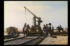 Men building railroad stock video footage