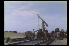 Men building railroad track stock video