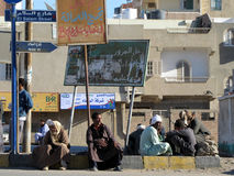 Men at bus stop Royalty Free Stock Photography