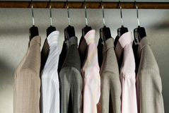 Men business clothing on hangers. Display opf men business clothing on hangers Royalty Free Stock Images