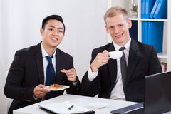 Men during business lunch in office Royalty Free Stock Photos