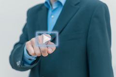 Men in business suit pressing play button royalty free stock photography