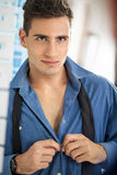 Men buttoning his shirt Royalty Free Stock Images