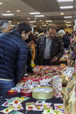 Men buying martisoare to celebrate beginning of spring on March Stock Images