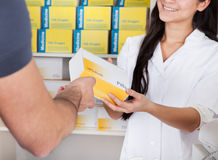 Men buying medicine at the drugstore Royalty Free Stock Image