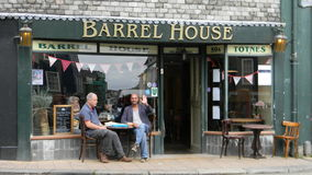 Men at a Cafe. Men enjoying a coffee at the Barrel House in Totnes UK Stock Photography