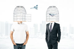 Men with cage heads Stock Photography
