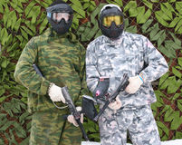 Men in camouflage. Two men in camouflage with guns Stock Photos
