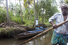 Men in canoe in Backwaters Stock Image