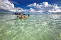 Two men Canoeing on the sea in the lagoon, paddles and Canoeing royalty free stock photography