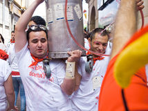 Men carry a can of wine festival of San Fermin Royalty Free Stock Image