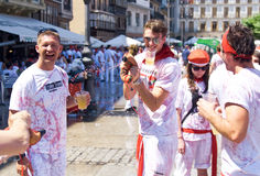 Men carry a can of wine festival of San Fermin Stock Images