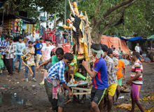 Men carry Durga idol for immersion in the Ganges river on the last day of Durga Puja. Royalty Free Stock Images