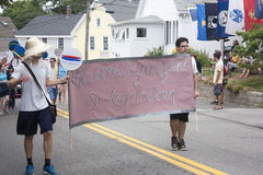 Men carry sign in the Wellfleet 4th of July Parade in Wellfleet, Massachusetts. Stock Photography