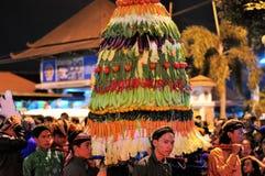 Men carry tower of vegetables, Yogyakarta city Royalty Free Stock Photos