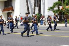 Men Carrying Axes Stock Image