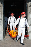 Men carrying cheese at the market Royalty Free Stock Photo