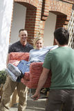 Men Carrying Woman On Sofa Outdoors Royalty Free Stock Image