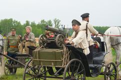Men on cart with Maxim machine gun Royalty Free Stock Image