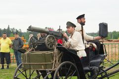 Men on cart with Maxim machine gun Royalty Free Stock Images