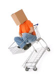 Men in with carton box on head sitting in shopping Royalty Free Stock Photography
