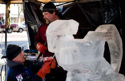 Men carving ice Stock Image