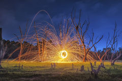 Men cast field Fire steelwool in the sunrise time. Stock Image