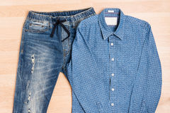 Men casual outfit jeans trendy style on wooden table Stock Image