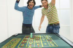 Men Celebrating At Roulette Table Royalty Free Stock Photo