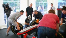 Men change car wheels Royalty Free Stock Image