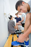 Men in changing room Royalty Free Stock Image
