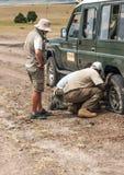 Men changing a wheel Royalty Free Stock Image