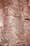Men chased by tiger frieze. Ancient Khmer bas relief carving of two men hiding up trees after being pursued by a tiger.  Wall of Bayon Temple, Angkor Thom, Siem Stock Photography