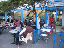 Men hanging out at a coffee shop. Sidi Bou Said. Tunisia stock images