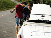 Men Checking Broke Down Car on Street Side with Open Hood Royalty Free Stock Photo