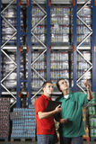 Men Checking Inventory At Warehouse Royalty Free Stock Photography