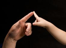 Men and child's fingers touching Royalty Free Stock Images