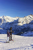 Men and child on ski at winter sport resort in swiss alps Royalty Free Stock Photos