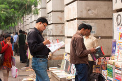Men choose magazines at the street book stall Stock Image